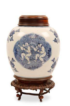 A CHINESE BLUE AND WHITE 'BOYS' JAR. Qing Dynasty, Kangxi era. Decorated with quatrefoil panels