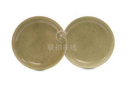 A PAIR OF CHINESE INCISED CELADON DISHES. Qing Dynasty, 18th Century. The interior of each with a
