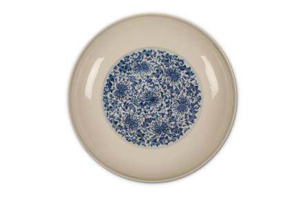 A CHINESE BLUE AND WHITE 'PEONY SCROLL' DISH. Qing Dynasty, Yongzheng mark and of the period. The