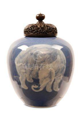 A CHINESE SLIP-DECORATED MONOCHROME BLUE 'ELEPHANT' JAR. Qing Dynasty. The rounded body painted in