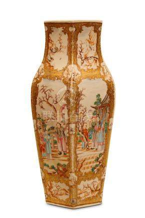 A CHINESE CANTON FAMILLE ROSE VASE. Qing Dynasty, 18th Century. Of hexagonal baluster form, the body