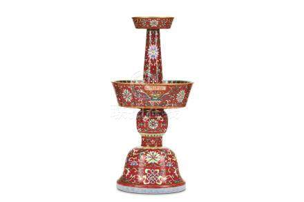 A CHINESE FAMILLE ROSE CANDLE STICK. Qing Dynasty, Qianlong mark and probably of the period.