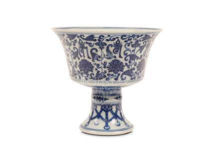 A CHINESE BLUE AND WHITE STEM BOWL. Qing Dynasty, Qianlong mark and of the period. The bowl is