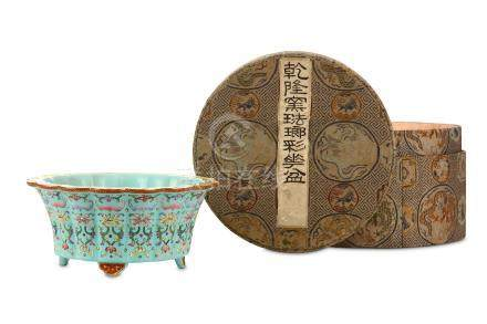 A CHINESE FAMILLE ROSE JARDINÈRE. Qing Dynasty, Qianlong era. Of lobed form raised on four ruyi-form