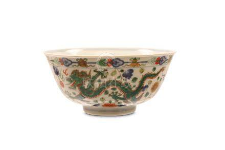 A CHINESE FAMILLE ROSE 'DRAGON AND PHOENIX' BOWL. Qing Dynasty, Daoguang mark and of the period. The