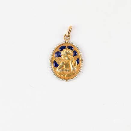 Médaille ancienne représentant un ange dans un décor émaillé bleu marine