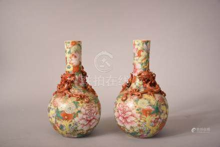 Pair of C19th Chinese famille rose 'mille fleur' bottle vases applied with dragon on the neck,