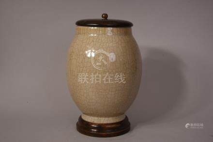 C18th/19th Chinese crackle glazed ovoid jar, wood cover and stand, overall 31cmH