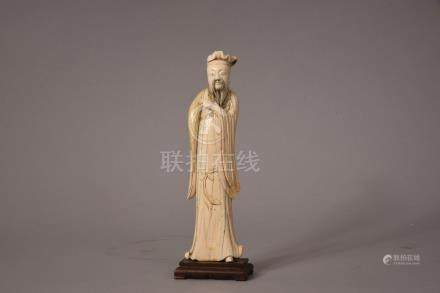 C17th/18th Chinese ivory carving of a scholar, 23cm high, wood stand.