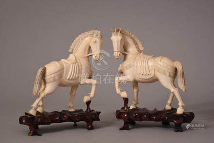 Pair of C19th Chinese ivory carvings of horses, 17.5cm high, wood stand. (2)