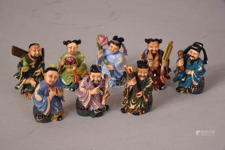 Set of eight C19th Chinese stained ivory carvings 'Eight Immortals', 6.2cm high max. (8)