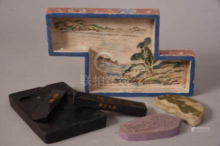 Chinese inkstone and four ink blocks; together with a famille rose Z-shaped 'landscape' dish, 20cm