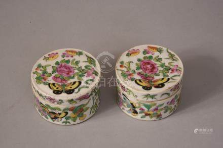 Pair of C19th Chinese famille rose circular boxes and covers decorated with butterflies flying