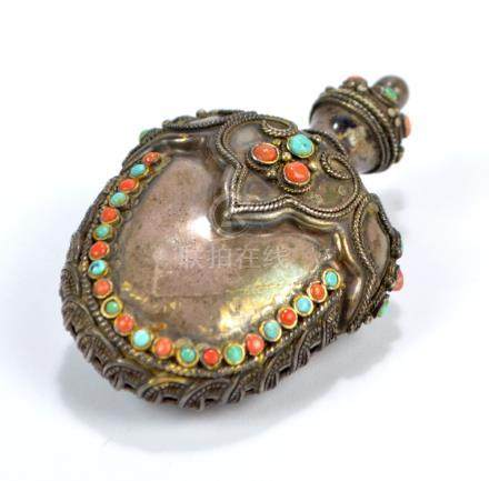 A Tibetan white metal snuff bottle of flat ovoid form decorated with turquoise,