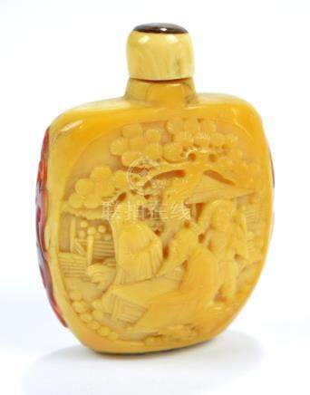 A 19th century Chinese carved hornbill snuff bottle of flat curved ovoid form,