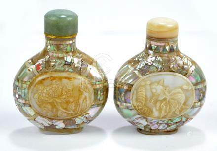 A near pair of Chinese mother of pearl veneered snuff bottles of flat globular forms,