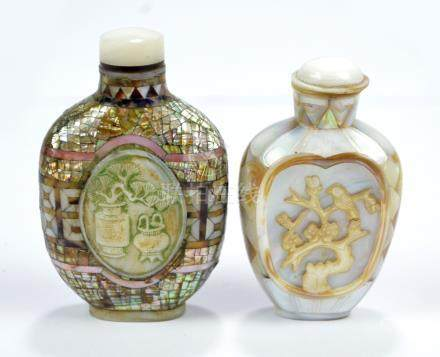 A Chinese mother of pearl snuff bottle of flat ovoid form centred with a carved pale green oval