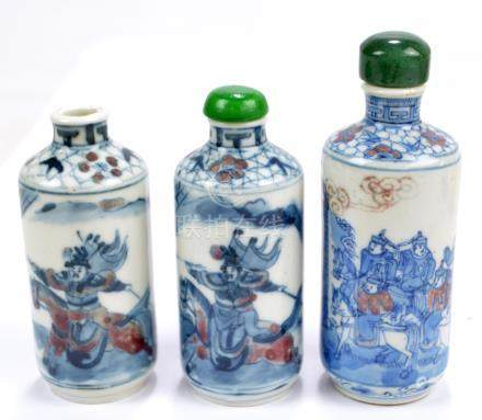 A pair of 19th century Chinese porcelain cylindrical snuff bottles painted in underglaze blue and