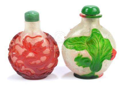 A Chinese red carved overlay glass snuff bottle of flat globular form,
