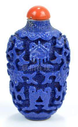 A Chinese blue glazed porcelain snuff bottle of flat ovoid form overall moulded with eight Buddhist