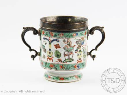 A Chinese famille verte silver mounted cup, Kangxi, of cylindrical form with domed foot,