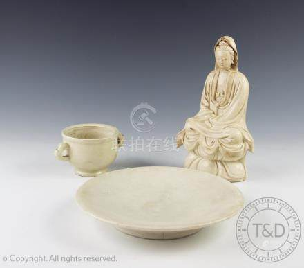 A Chinese Tang style white ware figure of Guanyin, on a lotus base, 20.