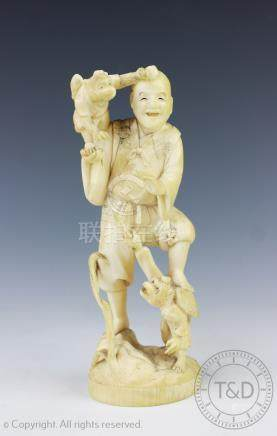 A Japanese carved ivory figure of a figure with two winged monkeys, Meiji Period 1868-1912,