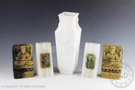 A pair of carved soapstone figural booked ends, each carved as Guanyin seated on a lotus throne,