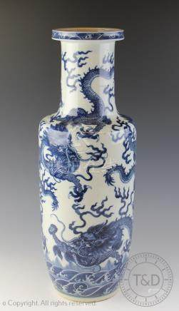 A Chinese porcelain blue and white rouleau vase, Qianlong seal mark,