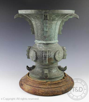 A large Chinese archaic Zhou style bronze Gu altar vessel, possibly 18th century,