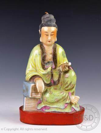 A Chinese porcelain figure of a Scholar, 20th century,