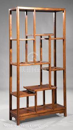 Chinese Hardwood Curio Stand, probably early 20th c., with asymmetrical arrangement of shelves