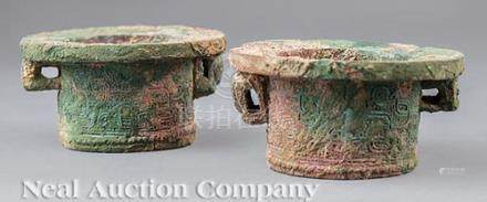 Pair of Chinese Bronze Chariot Fittings, probably Han Dynasty (206 BCE-220 CE), cast in low relief