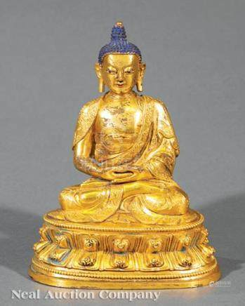 Sino-Tibetan Gilt Bronze Figure of Shakyamuni or Amitabha, Qing Dynasty (1644-1911), seated in