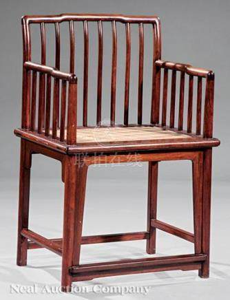 Chinese Hardwood Spindle-Back Armchair, late Qing Dynasty (1644-1911), shaped top rail, gently