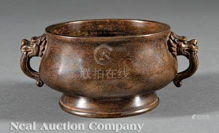 Chinese Bronze Censer, bombe body with lion's mask loop handles, base with apocryphal Xuande mark,