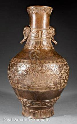 Archaistic Chinese Bronze Vase, cast with elephant mask handles and relief-bands of ruyi heads,