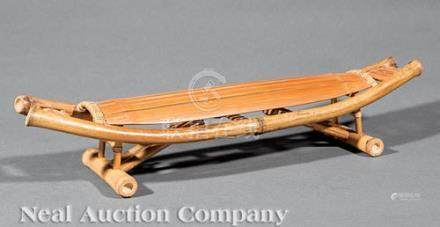 Chinese Bamboo Pillow, 19th c., bow-form with slatted neck rest and collapsible braced feet, h. 4