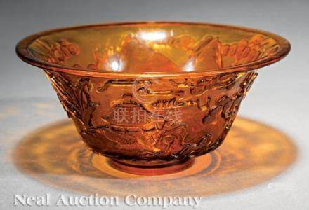 Chinese Carved Amber Glass Bowl, late 18th/early 19th c., carved with a landscape scene, h. 3 3/8