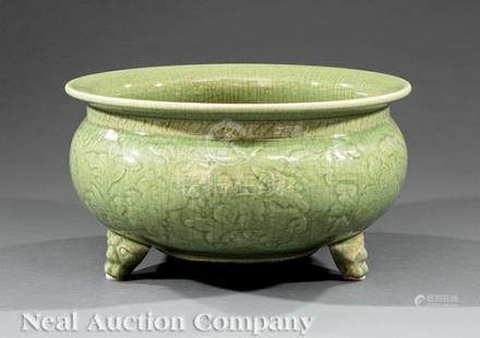 Chinese Celadon Porcelain Tripod Censer, probably 20th c., bulbous body with carved floral