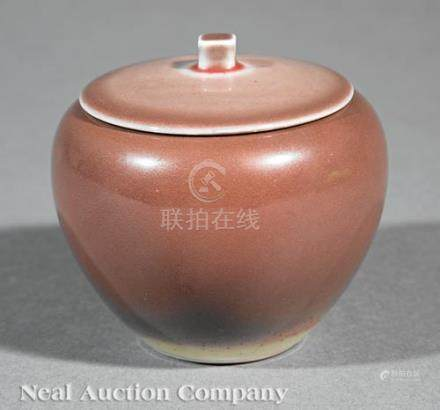 Chinese Peachbloom Glazed Porcelain Covered Jar, finialed domed cover, apple-form body with liver