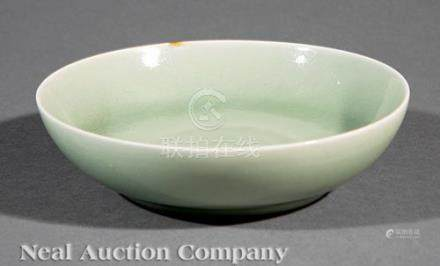 Chinese Celadon Porcelain Shallow Bowl, 19th/20th c., covered overall in a bubble-suffused seafoam