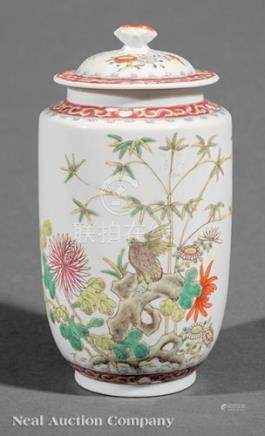 Chinese Famille Rose Porcelain Covered Jar, 20th c., decorated with a bird on rockwork amid