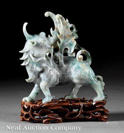 Chinese Mottled Green, White and Russet Jadeite Figure of a Qilin, 20th c., carved in a striding