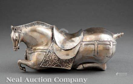 Chinese Silvered Metal Horse, 20th c., modeled recumbent wearing a harness and saddle, base with