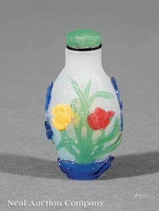 Chinese Four Color Overlay White Glass Snuff Bottle, 1750-1820, carved with a bat and butterfly amid