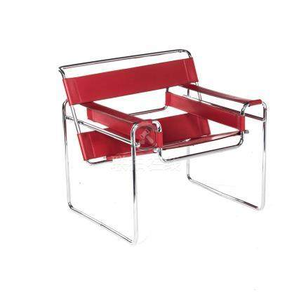 A WASSILY CHAIR DESIGNED IN 1925 BY MARCEL BREUER the red leather back and seat on a tubular steel