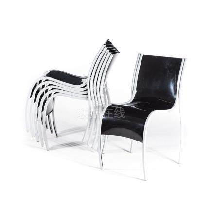 A SET OF SIX BLACK FANTASTIC PLASTIC ELASTIC CHAIRS DESIGNED BY RON ARAD FOR KARTELL each curved