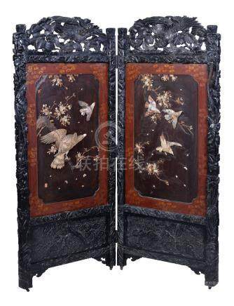 Y A Japanese Wood and lacquer Two-Fold Screen, the richly carved black wood frame decorated with