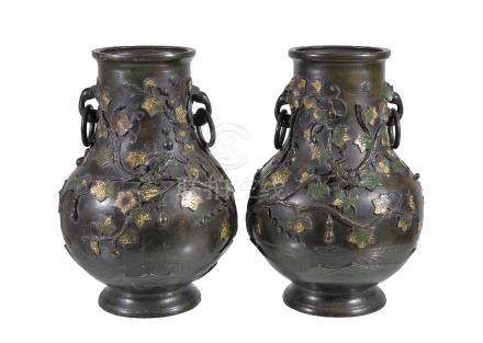 A pair of Chinese bronze and champleve vases, applied in relief with fruiting gourd vines and